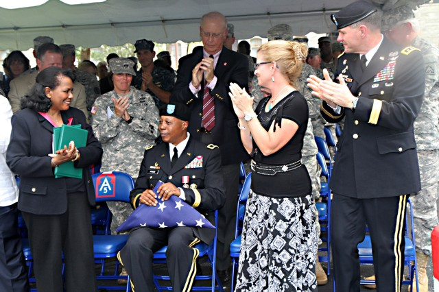 FORT SAM HOUSTON, Texas - Lt. Gen. Perry Wiggins (right), commanding general for U.S. Army North (Fifth Army) and senior commander for Fort Sam Houston and Camp Bullis, along with his wife, Annette, and Dr. Roslyn McQueen (left), McQueen's wife, join those gathered in a standing ovation Sept. 17 in honor of Maj. Gen. Adolph McQueen Jr., deputy commanding general for support, Army North, after he retired from the Army after 41 years of service to the nation. The retirement ceremony took place in the historic Quadrangle.