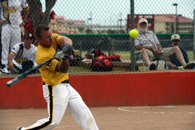 Staff Sgt. Kenny Turlington of Camp Humphreys, South Korea, goes 5-for-5 with four home runs to lead All-Army to a 23-8 victory over All-Air Force in the gold-medal game of the 2013 Armed Forces Softball Championships at Fort Sill, Okla., Sept. 17, 2013.