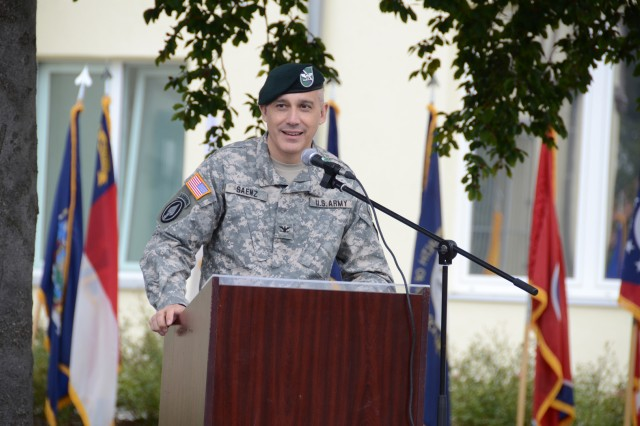Col. James Saenz, commander of U.S. Army Garrison Bavaria, addresses the crowd during the designation ceremony here, Sept. 24, outside the Tower Barracks Headquarters Building.