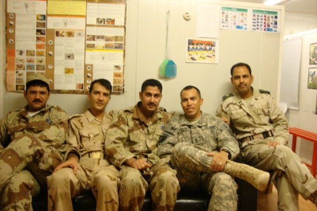 Master Sgt. Gregorio Villanuevaochoa poses for a photo with Iraqi Army medical staff and non-commissioned officers, in 2010.