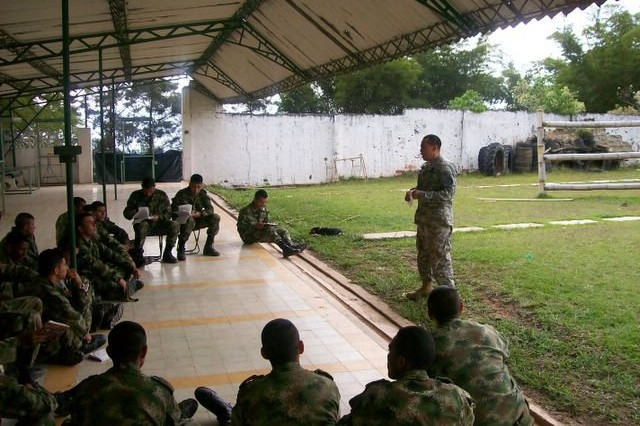 Then-Sgt. 1st Class Gregorio Villanuevaochoa teaches Columbian soldiers first aid.