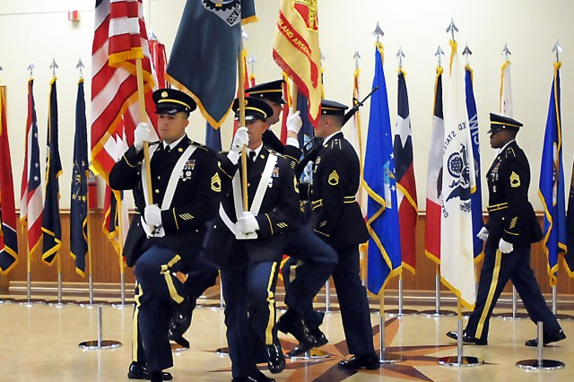 The color guard moves into position to post the colors at the Rock Island Arsenal Community Retirement & Retreat ceremony Sept. 19 in Heritage Hall. On the right is Sgt. 1st Class Jason Urquhart, color sergeant, U.S. Army Sustainment Command. (Photo by Jon Micheal Connor, ASC Public Affairs)