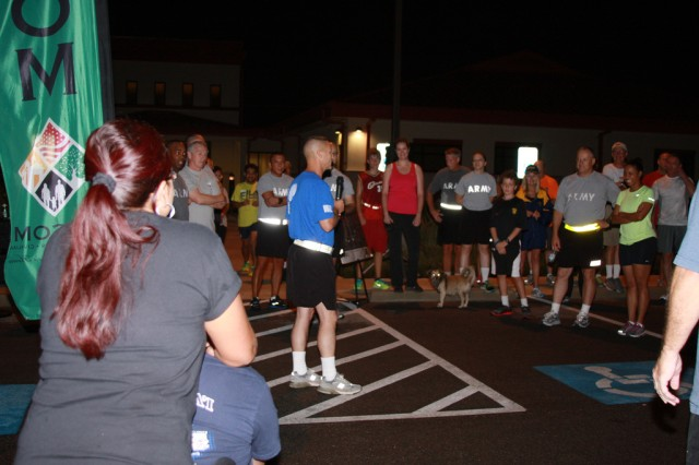 Command Sgt. Maj. Earl Rice, U.S. Army Installation Management Command senior enlisted adviser, encourages the team to commit to be fit, never give up on oneself or a battle buddy during the monthly IMCOM resiliency fun run/walk.