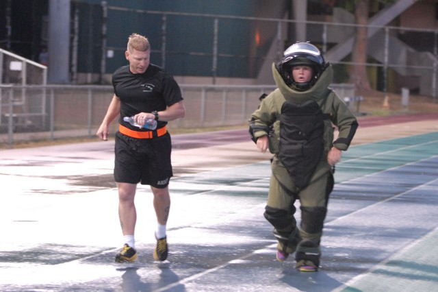 1st Lt. Ashley Sorensen of the 303rd Explosive Ordnance Disposal Battalion attempts a new world record by running a mile in 11 minutes, 6 seconds, while wearing a fully functional bomb disposal suit weighing more than 75 pounds, at the University of Hawaii-Manoa track, Sept. 23, 2013. Sorensen's time bested the existing record by more than two minutes, and pending review by the Guinness Book of World Records, it will become the official record for fastest female one-mile run in an EOD bomb disposal suit.