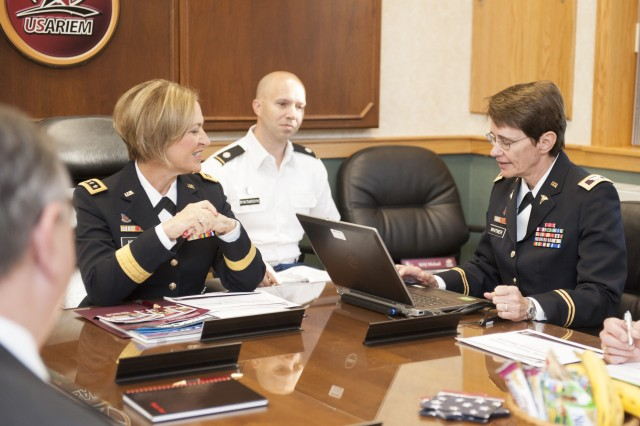 Army Surgeon General Lt. Gen. Patricia D. Horoho (left) speaks with Col. Deborah Whitmer, commander of the U.S. Army Research Institute of Environmental Medicine, Natick, Mass., during a Sept. 23, 2013, visit to USARIEM.