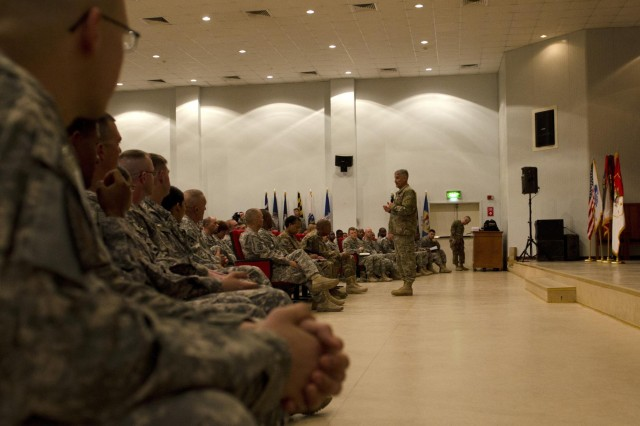The Sgt. Maj. of the U.S. Army Raymond F. Chandler III briefs Soldiers during a town hall at Camp Arifjan, Kuwait, Sept. 20, 2013. During the town hall meeting, Chandler discussed leadership issues and professional development opportunities that are vital to enlisted Soldiers.  (U.S. Army photo by Staff Sgt. Dayan Neely/Released)