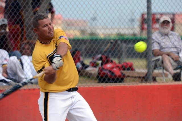 Pitcher Sgt. Eric Querry of Fort Hood, Texas, helps himself with a home run in All-Army's 23-8 victory over All-Air Force in the gold-medal game of the 2013 Armed Forces Softball Championships on Sept. 19 at Fort Sill, Okla.