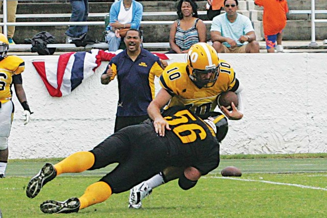 Alberto Rosario of N Troop, 3rd Squadron, 16th Cavalry, sacks the North Georgia Sports Academy quarterback Saturday in the Fort Benning Doughboys 38-24 win.
