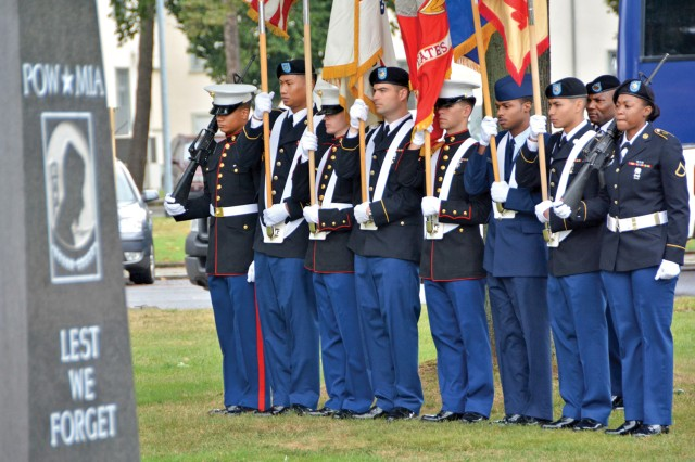 A mixed color guard of Airmen, Marines and Soldiers presents the colors during a 9/11 commemoration at Veterans Park on Clay Kaserne Sept. 11.