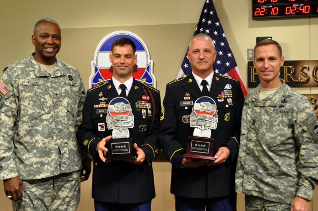 Staff Sgt. Jason C. Boyd, 3rd Battalion, 319th Airborne Field Artillery Regiment, 82nd Airborne Division and Sgt. 1st Class Craig A. Nabors, Headquarters Support Company, Headquarters and Headquarters Battalion, XVIII Airborne Corps, respectively, were named the 2013 U.S. Army Forces Command Active and Reserve Component Career Counselors of the Year during a Sept 25, 2013, ceremony at Fort Bragg, N.C. In this photo the winners pose with Brig. Gen. Barrye L. Price, FORSCOM's deputy chief of staff, G1, and the FORSCOM command sergeant major, Command Sgt. Maj. Christopher K. Greca.