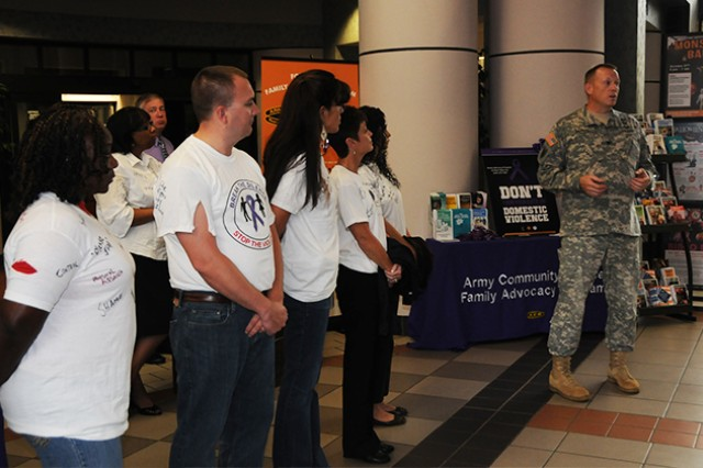 Col. Stuart J. McRae, Fort Rucker garrison commander, speaks at the Domestic Violence Awareness kickoff event last year in the lobby of Bldg. 5700.