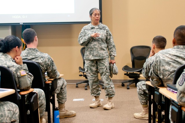 Lt. Col. Celia FlorCruz, Sexual Harassment/Assault Response and Prevention program manager, 7th Infantry Division, addresses a group of peer-to-peer trainees at a course, Aug. 26-29, 2013, on Joint Base Lewis-McChord, Wash.