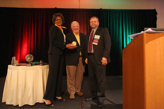 The Soldier Support Institute recently received the Pike's Peak Performance Award. Wanda Blackmon, left, team chief of Noncommissioned Officer Education System Training Development, and L.Z. Harrison, right, supervisory instructional systems specialist for the SSI, receive the award from Bob Pike, founder of the consulting firm The Bob Pike Group.