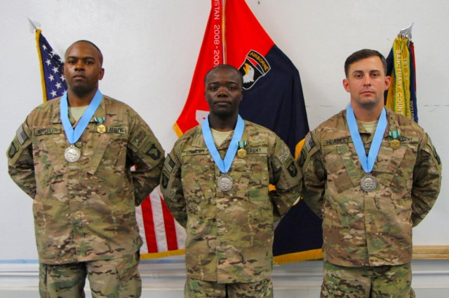 (From left) U.S. Army Sgt. 1st Class Danielle A. Whitaker, Sgt. 1st Class Tcherry Samedy and Sgt. 1st Class Spencer A. Headley, all with the 4th Brigade Combat Team, 101st Airborne Division, were inducted in the Sergeant Audie Murphy Club during a ceremony, Sept. 17, 2013, at Forward Operating Base Salerno, Afghanistan. (U.S. Army photo by Sgt. Justin A. Moeller, 4th Brigade Combat Team Public Affairs)