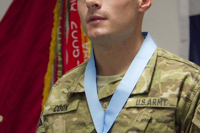 U.S. Army Staff Sgt. Joshua Cook, a cannon crew member with Battery A, 4th Battalion, 320th Field Artillery Regiment, 4th Brigade Combat Team, 101st Airborne Division (Air Assault), wears his Sergeant Audie Murphy medallion with pride after being inducted in the Sergeant Audie Murphy Club, during a ceremony at Forward Operating Base Lightning, Sept. 24, 2013. (U.S. Army photo by Sgt. Justin A. Moeller, 4th Brigade Combat Team Public Affairs)