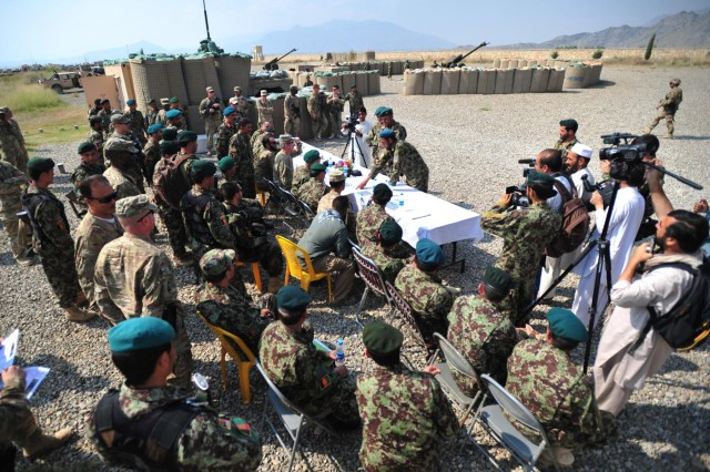 Gen. Karimi, chief of general staff, and Maj. Gen. Yaftali, commander, 203rd Afghan National Army Corps, receive an orientation to the walk and shoot live-fire exercise by members of the 1st Brigade, 203rd Afghan National Army Corps at Camp Parsa, Afghanistan, Sept. 26, 2013. The live-fire exercise consisted of the employment of a pair of D30 122 mm howitzers, dismounted infantry with mortars, and BM-12 107 mm rocket launchers, focusing on the brigade's ability to employ indirect fire and maneuver. (U.S. Army photo by Maj. Kamil Sztalkoper, 4th Brigade Combat Team Public Affairs office)