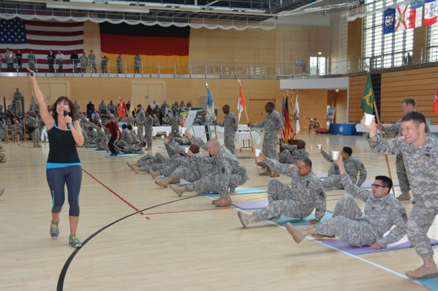 Maria Diaz, management support assistant for Wiesbaden's Sports and Fitness, leads area Soldiers in some friendly competition during Ready and Resilient training, Sept. 25, 2013, in Wiesbaden, Germany.