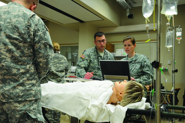 Members of the 865th Army Reserve Combat Support Hospital (Combat Surgical Hospital), out of Utica, N.Y., practice teamwork in the Mayo Clinic's Multidisciplinary Simulation Center in Rochester, Minn.
