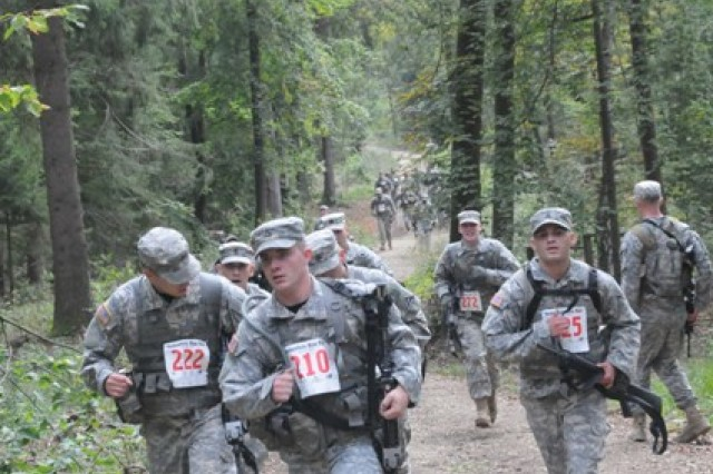 Soldiers competing in the U.S. Forces Europe Combat Cross Country Championships at Hohenfels, Sept. 27, make a last push for the finish line.