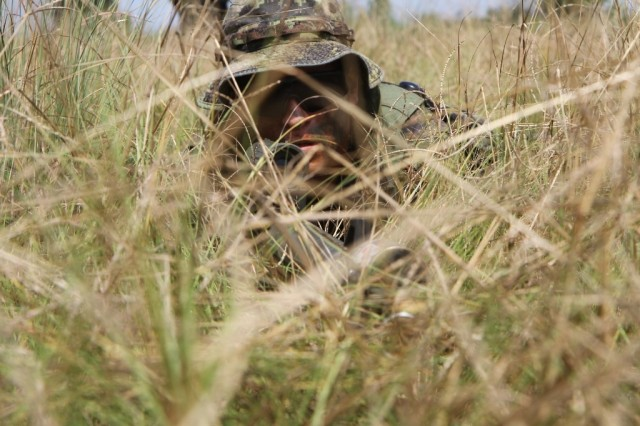 Master Corporal Ierullo Cesare, Royal Regiment of Canada, lays in wait for the right moment to neutralize the enemy. He and his unit are training with the 48th Infantry Brigade Combat Team as part of an eXportable Combat Training Capability in order to maintain their combat effectiveness. (U.S. Army photo by Sgt. 1st Class Stephanie Widemond, 188th Infantry Brigade Public Affairs)
