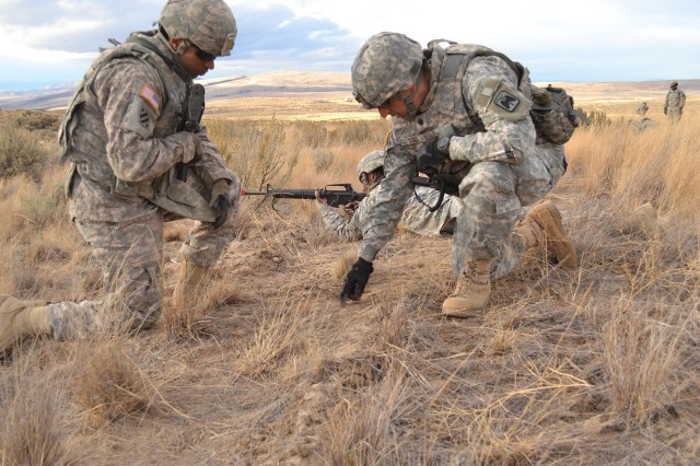 Lt. Col. Mark Sisco, 46th Aviation Support Battalion commander, provides guidance to a Soldier during a field training exercise.