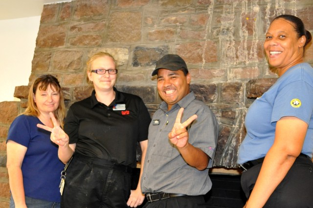 Staff at building 21's three restaurants shared their ghost stories near the dining facility fireplace, a fixture from its previous life as an officers club during and after World War II. From left are Kim Bradley, Einstein's Bagels foreman; Anna Mai Taylor, Manchu Wok foreman; Elmerson Diaz, Taco Bell customer service employee; and Diane Pitts, food court manager.