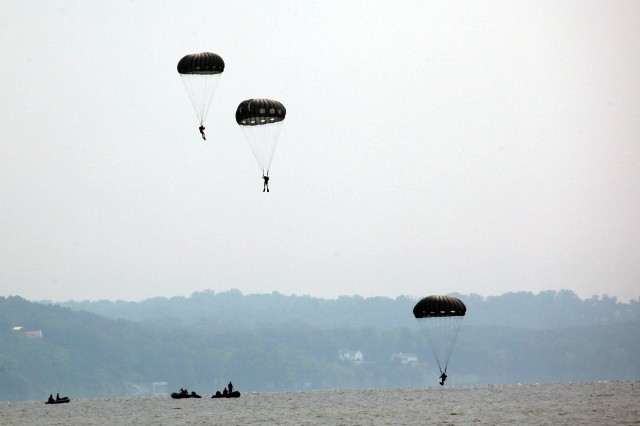 Green Berets from the 5th Special Forces Group (Airborne) parachute into a water drop zone marking the beginning of a two-day long competition testing their abilities as an Operational Detachment Alpha.