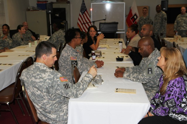 Members of First Army Division East attend a prayer breakfast held Sept. 26, 2013 at the post chapel on Fort George G. Meade, Md. The breakfast focused on recognizing the role of noncommissioned officers, their role as shepherds of Soldiers, and showing how a deep-seated faith can increase their spiritual resilience. (U.S. Army photo by Staff Sgt. Stephen Crofoot, First Army Division East Public Affairs)