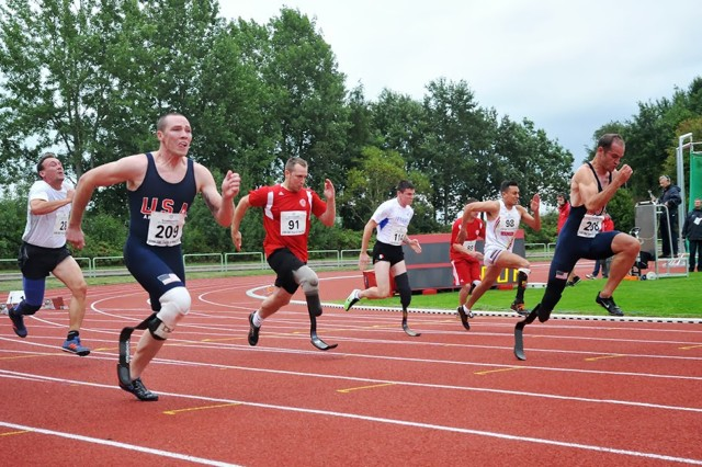 Sgt. Rob Brown (far right) of the U.S. Army World Class Para-Athlete Program andSgt. Ryan McIntosh (left) of Joint Base San Antonio-Fort Sam Houston, Texas, sprint to a 1-2 finish in the men's below knee amputee 100 meters at the Conseil International du Sport Militaire's 2013 World Para-Track and Field Championships in Warendorf, Germany.