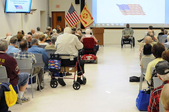 Col. Gregory D. Gadson, Fort Belvoir Garrison commander, speaks to retired servicemembers and Families during Fort Belvoir's annual Retiree Appreciation Day at Barden Education Center, Friday.