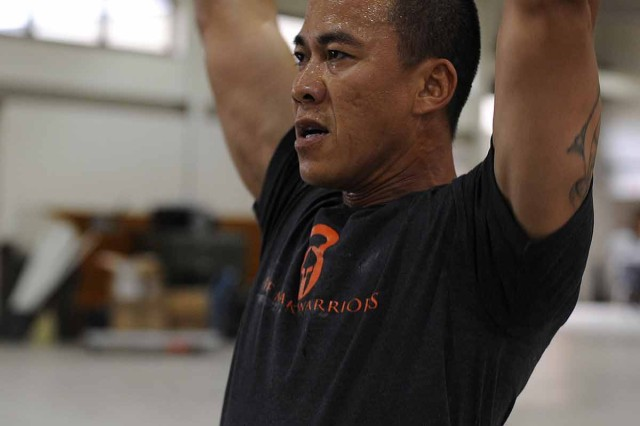 "1st Lt. Bau Phan conducts the ""Hope for Cures"" workout of the day. Phan is a CrossFit certified instructor and CrossFit Camp Mabry board member.  (U.S. Army National Guard photo by Staff Sgt. Malcolm McClendon)"