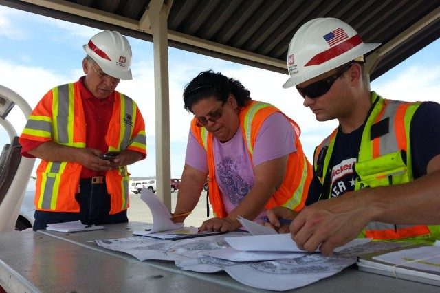 USACE Electrical Engineer Mehrbad Golshani, Civil Engineer Tech Patricia asquez and Civil Engineer Eric Strom take a break from assessing storm damage and review list of future inspections. A strong storm and flash flood that struck Fort Irwin and The National Training Center caused an approximate $50 million in damages to the fort, Aug. 25. There was no loss of life or injuries reported. The U.S. Army Corps of Engineers Los Angeles district sent a response team of engineering professionals to Fort Irwin to assess damage soon after a monsoon storm hit. The team inspected 166 buildings for damages.
