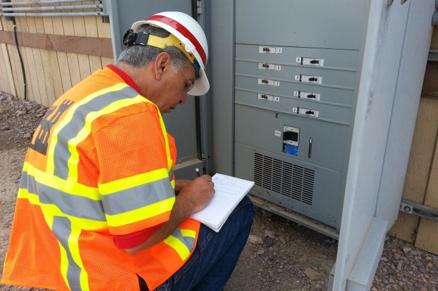 Mehrbad Golshani, an electrical engineer with the USACE Los Angeles District inspect an electrical panel for damage outside of one of Fort Irwin's office buildings. A strong storm and flash flood that struck Fort Irwin and The National Training Center caused an approximate $50 million in damages to the fort, Aug. 25. There was no loss of life or injuries reported. The U.S. Army Corps of Engineers Los Angeles district sent a response team of engineering professionals to Fort Irwin to assess damage soon after a monsoon storm hit.