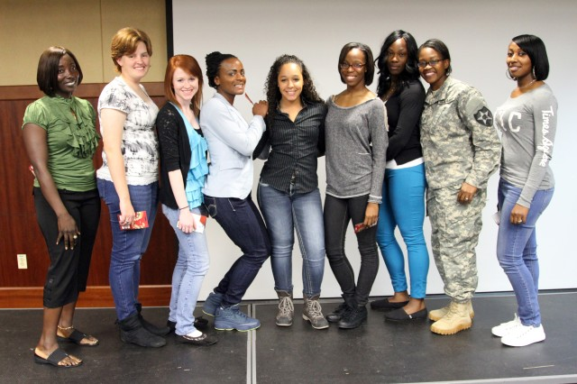 "Soldiers from 2nd Combat Aviation Brigade receive gift cards for volunteering in the 'What not to Wear"" fashion show during Female Mentorship Training Sep. 18 at the Community Fitness Center on Camp Humphreys. (U.S. Army photo by SGT Nicole Hall, 2nd CAB Public Affairs)"