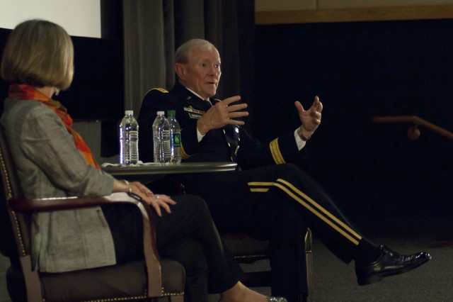 U.S. Army Gen. Martin E. Dempsey, the chairman of the Joint Chiefs of Staff, right, answers a question during a town hall with service members, families and civilians in Seoul, South Korea, Sept. 30, 2013. Dempsey and his wife, Deanie Dempsey, visited with over 300 military community members stationed throughout South Korea, where they spoke about the goals and challenges of the Department of Defense. (Photo by Army Staff Sgt. Luke A. Graziani)
