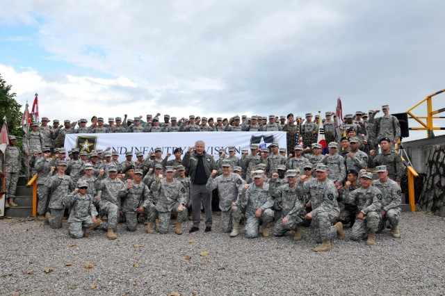 Secretary of Defense Chuck Hagel poses with Soldiers in 4th Squadron, 7th Cavalry, 1st Armored Brigade Combat Team, 2nd Infantry Division, Sept. 30, 2013, at Rodriquez Live Fire Complex, South Korea. Hagel observed a live-fire demonstration by units in the 2nd Infantry Division.