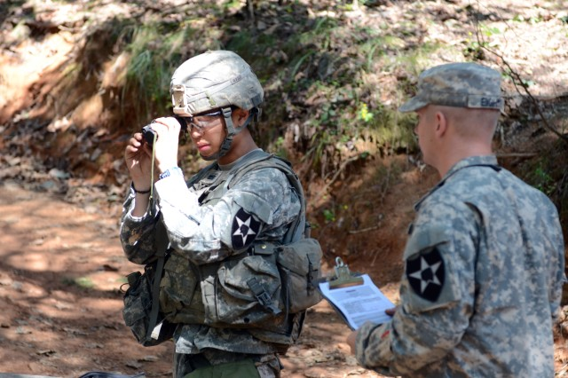 "WARRIOR BASE, South Korea "" A Korean Augmentation to the U.S. Army goes through bore sighting proficiency testing during the Expert Infantry Badge testing at Warrior Base, Sept. 25, 2013. KATUSAs are eligible to earn the EIB. All rules and guide lines apply to them as well. So they must have a primary MOS in their Army's Infantry. They must qualify expert on their assigned weapon just as the American Infantryman is required to do. (U.S. Army photo by, Cpl. Kwon Yong-joon, 1st ABCT, PAO)."