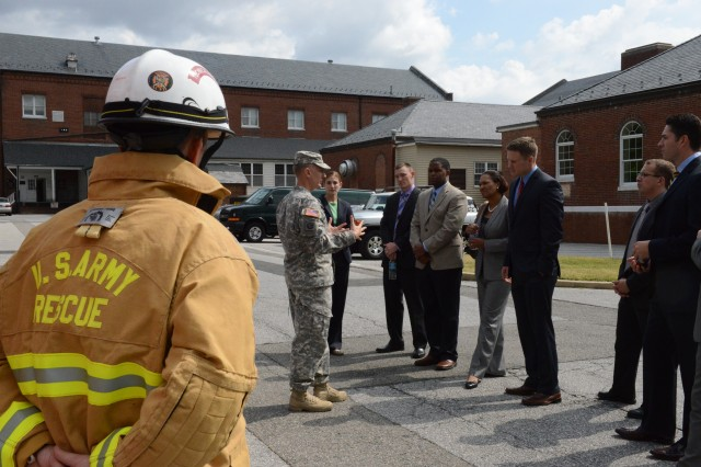 Capt. Michael Riccitello III, 911th Engineer company commander, briefs 24 Army Congressional Fellows on the company's unique mission during a tour o at Fort Lesley J. McNair, Sept. 27.