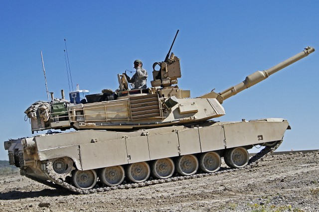 "Soldiers assigned to the 2nd ""Stallion"" Battalion, 8th Cavalry Regiment, 1st ""Ironhorse"" Brigade Combat Team, 1st Cavalry Division, prepare an M1A2 Abrams tank for a firing iteration during the Stallion's fall gunnery, Sept. 23, 2013, at Fort Hood, Texas. This gunnery exercise is the Stallions second qualification this year."