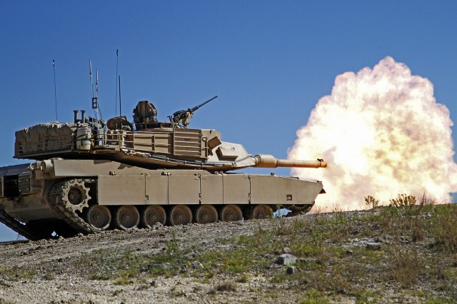 "Soldiers with 2nd ""Stallion"" Battalion, 8th Cavalry Regiment, 1st ""Ironhorse"" Brigade Combat Team, 1st Cavalry Division, conduct a firing iteration of gunnery training with an M1A2 Abrams tank during the Stallions fall gunnery, Sept. 23, 2013, at Fort Hood, Texas. This gunnery will prepare Stallions for upcoming training exercises in November, as well as a rotation to the National Training Center in February."