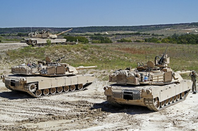 "Soldiers with the 2nd ""Stallion"" Battalion, 8th Cavalry Regiment, 1st ""Ironhorse"" Brigade Combat Team, 1st Cavalry Division, complete a firing iteration of gunnery training with an M1A2 Abrams tank during the Stallions fall gunnery, Sept. 23, 2013, at Fort Hood, Texas."