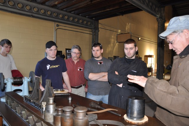 Bob Rawls, right, talking to high school students and their instructor about the machining techniques and procedures used during the late 1800s.