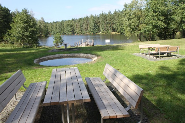 The Wild B.O.A.R., which stands for Bavaria Outdoor Adventure & Recreation, features picnic tables and a boat dock on Dickhaeuter Lake at Grafenwoehr Training Area, Germany.