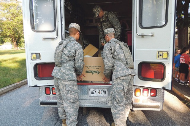 Soldiers load boxes of donated food into an American Red Cross truck. The food will be kept at the Battle Buddy Resource Center, which along with the American Red Cross, will have its grand opening at 4 p.m. Oct. 4 at 7800 Anderson Avenue.