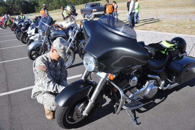 Staff Sgt. Peter Flynn, Moncrief Army Community Hospital, conducts safety inspections on motorcycles Friday morning at Hilton Field.