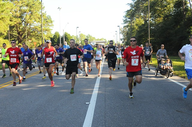 Bikers and runners begin the Fort Rucker Hispanic Heritage Gate-to-Gate Run Sept. 28. Participants had to run from the Ozark gate to the Daleville gate in order to complete the course.