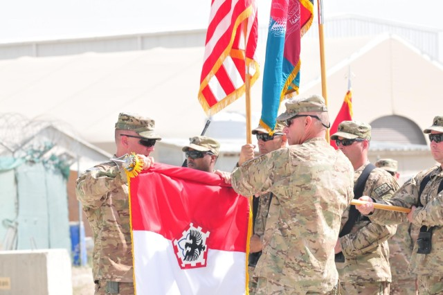 Col. Nicholas Katers (left) and Command Sgt. Maj. Kevin Bryan, command team for 555th Engineer Brigade, case their brigade colors during the Theater Engineer Brigade's transfer of authority ceremony, Oct. 2. The newly arrived 130th Engineer Brigade, Joint Task Force Sapper, has assumed control from the outgoing 555th, JTF Triple Nickel. The NATO-led International Security Assistance Force in Afghanistan looks to the Theater Engineer Brigade for a critical triad of engineering needs, including training Afghan National Army engineer units, construction and deconstruction projects, and removal of enemy roadside bombs along key roadways. (Photo by U.S. Army 1st Lt. Laura Beebe, 130th Engineer Brigade Public Affairs)