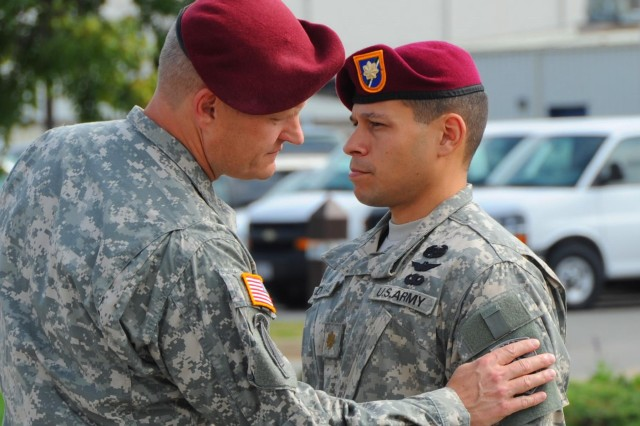 FORT CAMPBELL, KY -- Col. John R. Evans, regimental commander, 160th Special Operations Aviation Regiment (Airborne), places the U.S. Army Special Operations Aviation Command patch onto Maj. Keith Sandoval, executive officer, 1st Battalion, 160th SOAR (A), during the USASOAC shoulder-sleeve insignia ceremony, Oct. 1, at Fort Campbell, Ky.