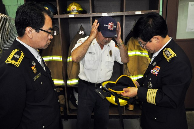 Seoul Fire Disaster Headquarters' officials visit Yongsan Fire Department and inspect through firefighters' equipments, Sept. 24. (U.S. Army photo by Cpl. Jung Jihoon)