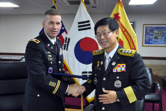 Col. Michael. E. Masley, commander of U.S. Army Garrison Yongsan and Kwon Sun-Kyung, fire marshal of Seoul Fire and Disaster Headquarters, shake hands after signing their mutual aid agreement, Sept. 24. (U.S. Army photo by Cpl. Jung Jihoon)